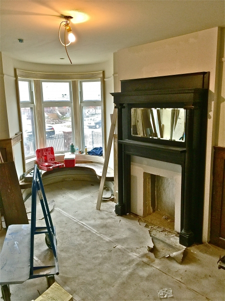 Original fireplace mantel in place in the parlor